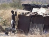 17 July 2010: A woman in Killarney informal settlement demolishes her shelter - evicted and on the move again, exactly 5 years after OM