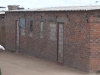 "There are 18 government-funded, ""Operation Garikai"" houses in Hopley farm, Harare, where 3,800 displaced live: windows and doors have been bricked up because there are no door or window frames, and also no sewerage, water or electricity, five years after being built. [July 2010]"
