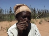 With her failed harvest in the background, this old lady dumped in rural Matabeleland in 2005 recounts the deaths of two children, and the burden of a daughter who has lapsed into mental illness: while barely surviving, she has no energy to move again. [May 2010]