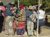 """PASSOP, an NGO supporting Zimbabweans in De Doorns, is banned from entering the IDP camp, and here holds a meeting with them through the fence! They deliver """"the Zimbabwean"""" newspaper – news from home read avidly. [30 May 2010]"""